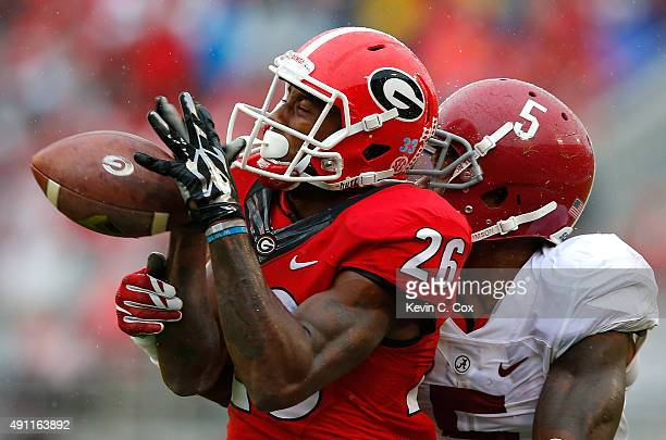 Malcolm Mitchell of the Georgia Bulldogs fails to pull in this reception against Cyrus Jones of the Alabama Crimson Tide at Sanford Stadium on...