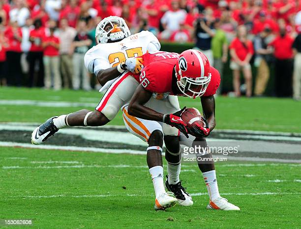 Malcolm Mitchell of the Georgia Bulldogs is tackled by Justin Coleman of the Tennessee Volunteers at Sanford Stadium on September 29, 2012 in Athens,...
