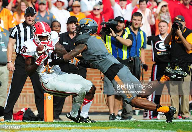Malcolm Mitchell of the Georgia Bulldogs makes a catch for a second quarter touchdown against Cameron Sutton of the Tennessee Volunteers on October...