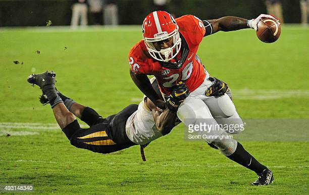 Malcolm Mitchell of the Georgia Bulldogs runs with a catch against Kenya Dennis of the Missouri Tigers on October 17 2015 in Atlanta Georgia Photo by...
