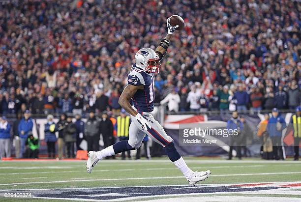 Malcolm Mitchell of the New England Patriots celebrates scoring a touchdown during the second quarter against the Baltimore Ravens at Gillette...