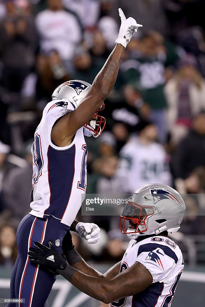 Malcolm Mitchell #19 of the New England Patriots celebrates with Martellus Bennett #88 after scoring a touchdown against the New York Jets during the second quarter in the game at MetLife Stadium on November 27, 2016 in East Rutherford, New Jersey.