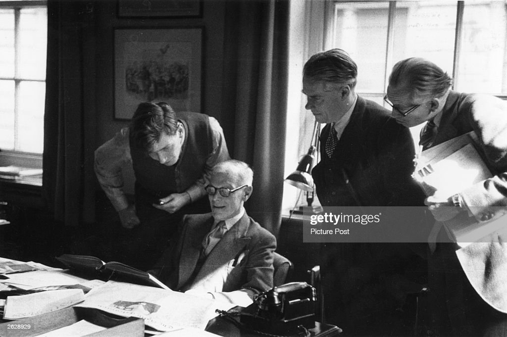 Malcolm Muggeridge (1903 - 1990), the English journalist and sage. To his left is the Hon Peter Dickinson and to his right is Antony Powell and J B Boothroyd Original Publication: Picture Post - 6896 - Punch Gets A New Editor - unpub. Original Publication: People Disc - HN0463