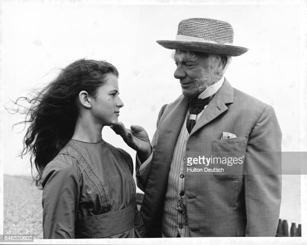 Malcolm Muggeridge the English journalist talks to AnneMarie Mallik at the filming for the BBC TV production of Alice in Wonderland He is to play the...