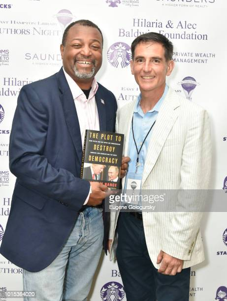Malcolm Nance and Dennis Fabiszak attend Authors Night At East Hampton Library on August 11, 2018 in East Hampton, New York.