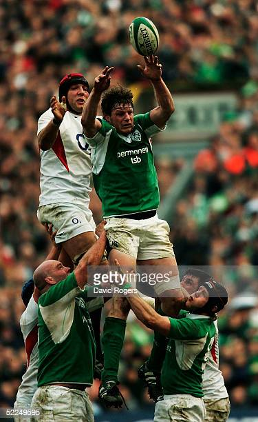 Malcolm O'Kelly of Ireland and Ben Kay of England reach for the ball during the RBS Six Nations Championship match between Ireland and England at...