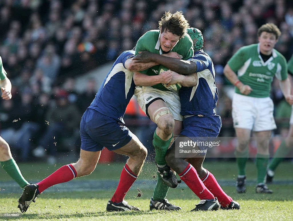 Malcolm O'Kelly of Ireland is stopped by the French defence during the RBS Six Nations Championship match between Ireland and France at Lansdowne Road on March 12, 2005 in Dublin, Ireland.