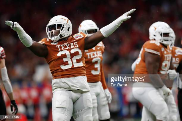 Malcolm Roach of the Texas Longhorns celebrates a tackle in the second quarter against the Utah Utes during the Valero Alamo Bowl at the Alamodome on...