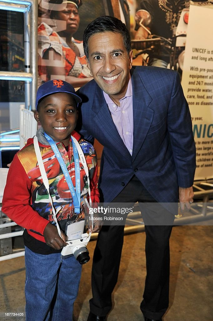 Malcolm Robinson and Dr.Sanjay Gupta attends The UNICEF Experience at Mason Murer Fine Art Gallery on April 28, 2013 in Atlanta, Georgia.