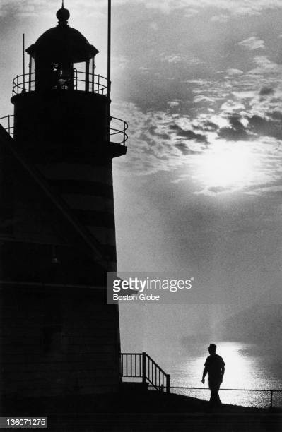 Malcolm Rouse walks along the shoreline by Quoddy Head Lighthouse Unknown year