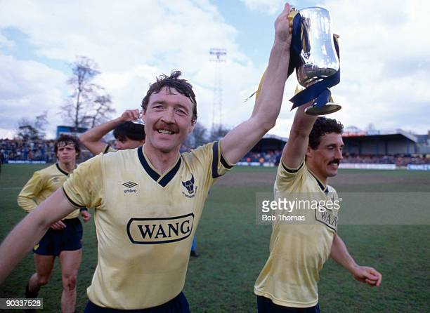 Malcolm Shotton and John Trewick of Oxford United parade the Milk Cup trophy after the Oxford United v Arsenal Division 1 match held at the Manor...