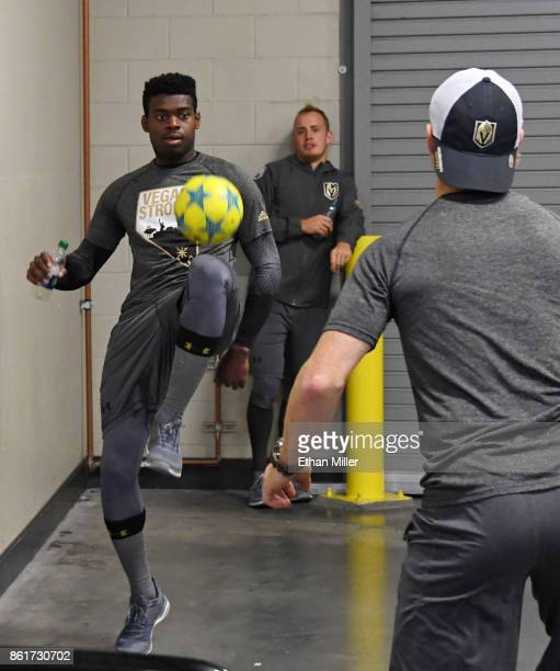 Malcolm Subban of the Vegas Golden Knights and Nate Schmidt play a game with a soccer ball before the team's game against the Boston Bruins at...