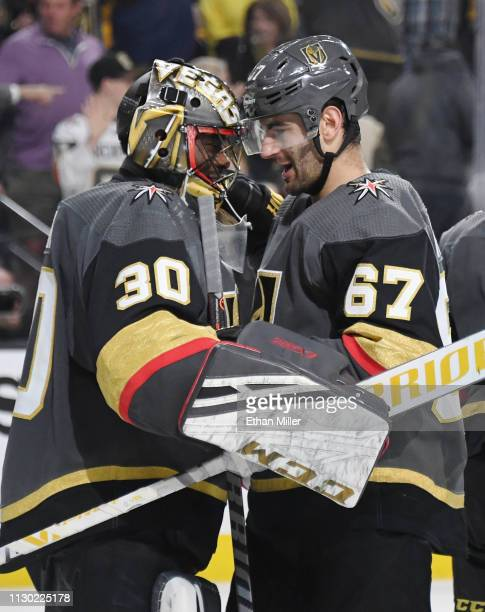 Malcolm Subban and Max Pacioretty of the Vegas Golden Knights celebrate on the ice after the team's 51 victory over the Nashville Predators at...