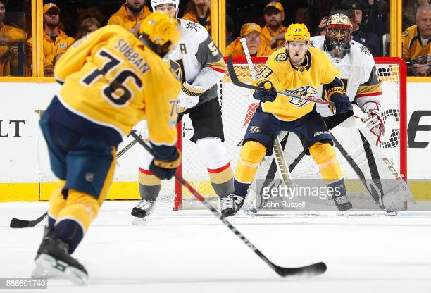 Malcolm Subban of the Vegas Golden Knights and Viktor Arvidsson of the Nashville Predators eye the shot of Predators PK Subban during an NHL game at...