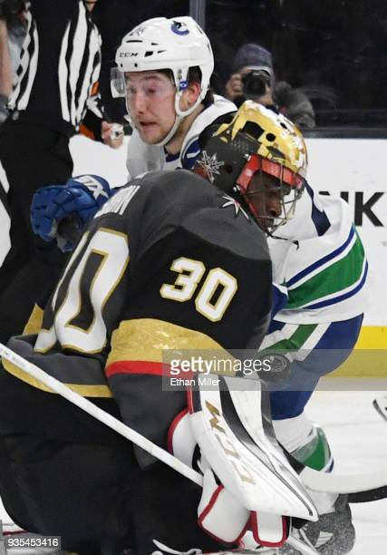 Malcolm Subban of the Vegas Golden Knights blocks a shot by Reid Boucher of the Vancouver Canucks in the third period of their game at TMobile Arena...