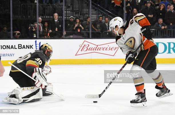 Malcolm Subban of the Vegas Golden Knights blocks a shot by Rickard Rakell of the Anaheim Ducks during a shootout at TMobile Arena on December 5 2017...