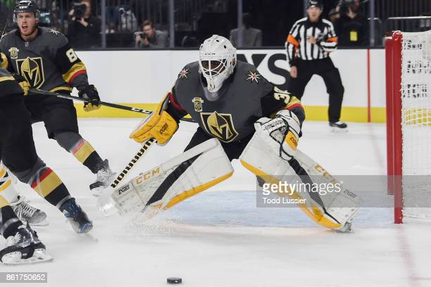Malcolm Subban of the Vegas Golden Knights defends against the Boston Bruins during the game at TMobile Arena on October 15 2017 in Las Vegas Nevada