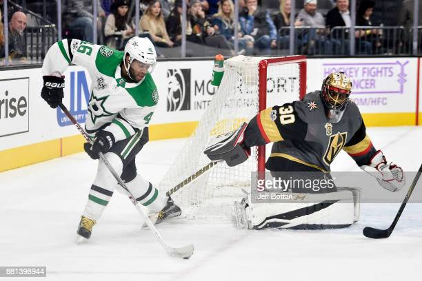 Malcolm Subban of the Vegas Golden Knights defends his goal against Gemel Smith of the Dallas Stars during the game at TMobile Arena on November 28...