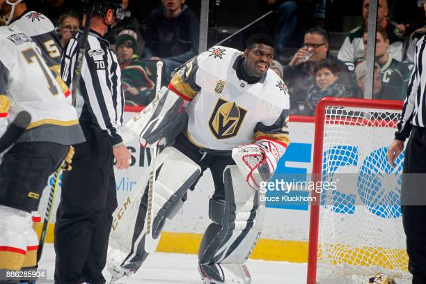 Malcolm Subban of the Vegas Golden Knights has his mask knocked off against the Minnesota Wild during the game at the Xcel Energy Center on November...