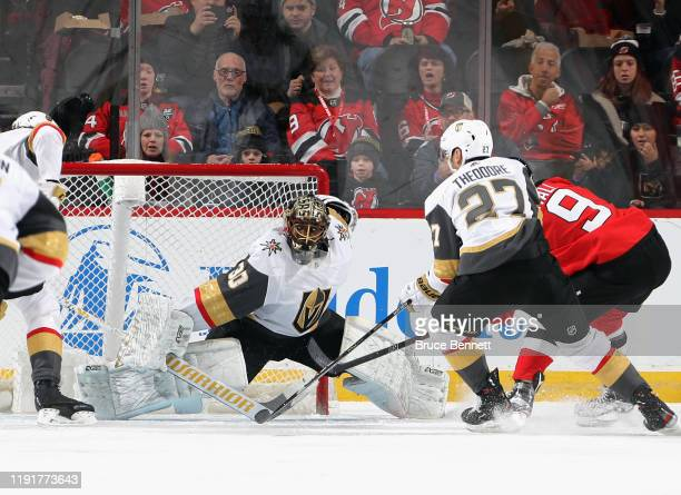 Malcolm Subban of the Vegas Golden Knights makes the first period save against Taylor Hall of the New Jersey Devils at the Prudential Center on...