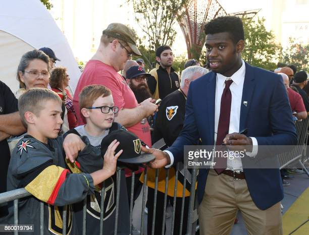 Malcolm Subban of the Vegas Golden Knights signs autographs for fans as he arrives at the team's inaugural regularseason home opener against the...