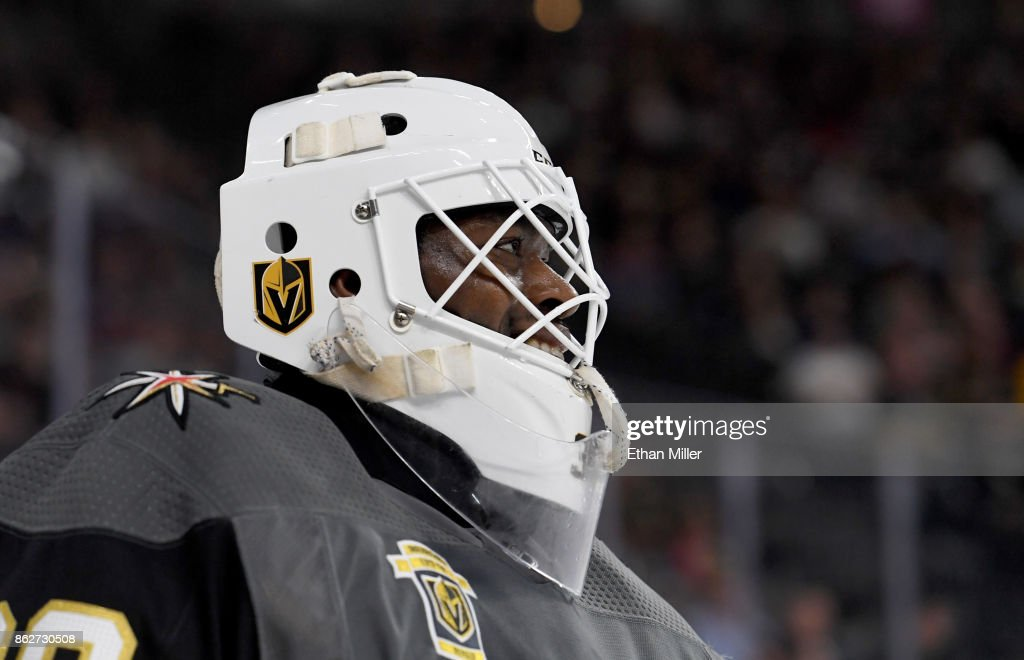Malcolm Subban #30 of the Vegas Golden Knights smiles during a break in the first period of a game against the Buffalo Sabres at T-Mobile Arena on October 17, 2017 in Las Vegas, Nevada. The Golden Knights won 5-4 in overtime.