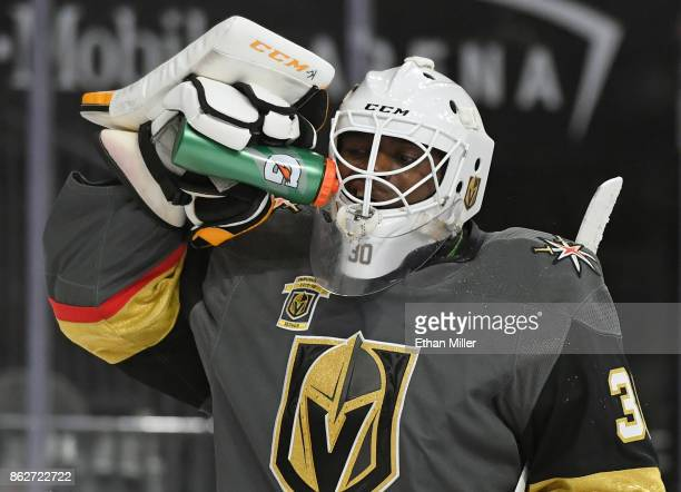 Malcolm Subban of the Vegas Golden Knights takes a drink during a break in the first period of a game against the Buffalo Sabres at TMobile Arena on...