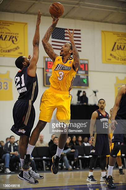 Malcolm Thomas of the Los Angeles DFenders attempts a shot against Damian Johnson of the Bakersfield Jam during a game at Toyota Sports Center on...