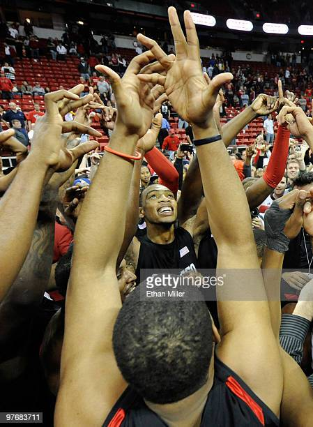 Malcolm Thomas of the San Diego State Aztecs and his teammates celebrate on the court after defeating the UNLV Rebels 5545 in the championship game...