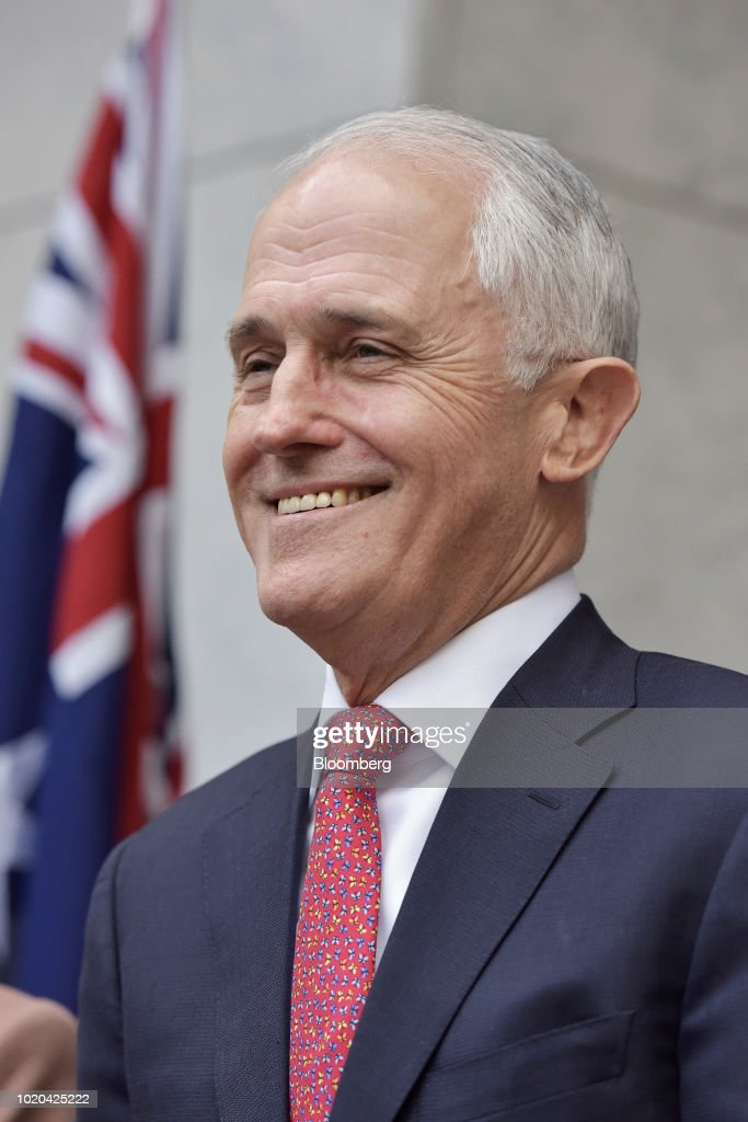 Malcolm Turnbull, Australia's prime minister and leader of the Liberal Party, smiles during a news conference in Canberra, Australia, on Tuesday, Aug. 21, 2018. Turnbull survived a leadership vote on Tuesday but may be challenged again within days amid growing unease among party colleagues about the government's slumping poll ratings. Photographer: Mark Graham/Bloomberg via Getty Images