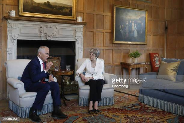 Malcolm Turnbull Australia's prime minister left gestures while speaking as Theresa May UK prime minister listens during a meeting at Chequers...