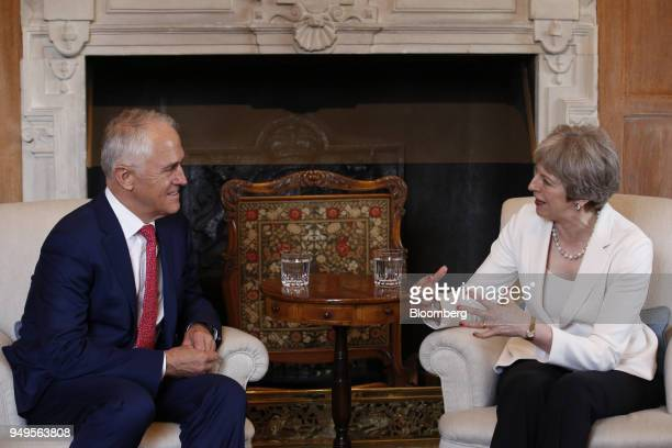 Malcolm Turnbull Australia's prime minister left reacts as Theresa May UK prime minister speaks during a meeting at Chequers Aylesbury UK on Saturday...