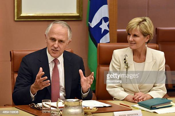 Malcolm Turnbull Australia's prime minister left speaks as Julie Bishop Australia's foreign minister looks on during a Cabinet meeting in Canberra...