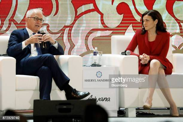 Malcolm Turnbull Australia's prime minister left speaks as Sheryl Sandberg chief operating officer of Facebook Inc looks on during the AsiaPacific...