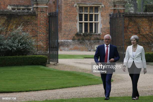 Malcolm Turnbull Australia's prime minister left walks with Theresa May UK prime minister during a meeting at Chequers in Aylesbury UK on Saturday...