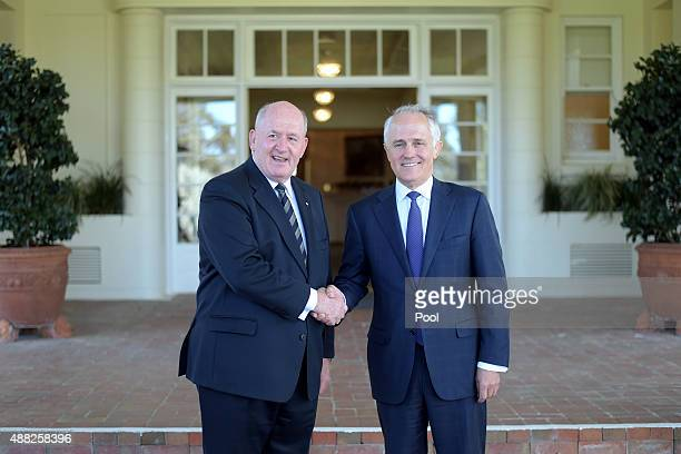 Malcolm Turnbull shakes hands with Australia's GovernorGeneral Sir Peter Cosgrove after being swornin as Australia's 29th Prime Minister at...
