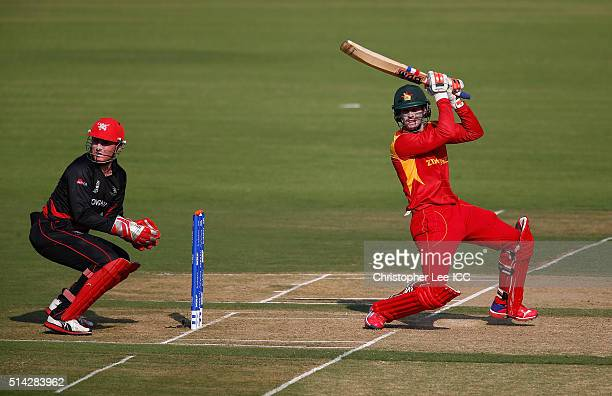 Malcolm Waller of Zimbabwe in action with wicket keeper James Atkinson of Hong Kong during the ICC Twenty20 World Cup Group B match between Zimbabwe...