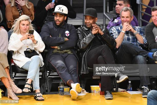 Malcolm Washington and Denzel Washington attend a basketball game between the Los Angeles Lakers and the Dallas Mavericks at Staples Center on...