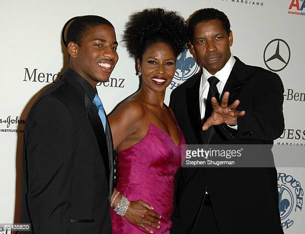 Malcolm Washington Pauletta Washington and actor Denzel Washington pose during the cocktail reception at the 30th anniversary Carousel of Hope Ball...