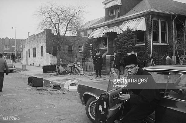 Malcolm X gets out of his car at his house, which had been firebombed the night before, almost certainly by his former colleagues in the Nation of...