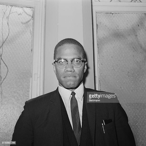 Malcolm X leading spokesman for the Black Muslim movement is shown with the dome of the Connecticut Capitol behind him as he arrived 6/4 in Hartford...