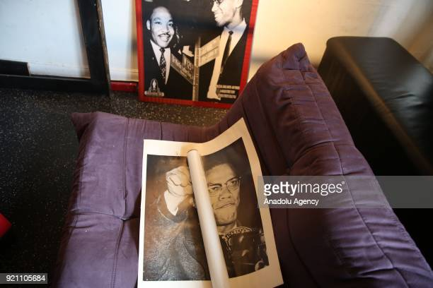 Malcolm X poster lies on a couch ahead of 53rd anniversary of Malcolm X's assassination in Harlem neighborhood of Manhattan borough in New York...