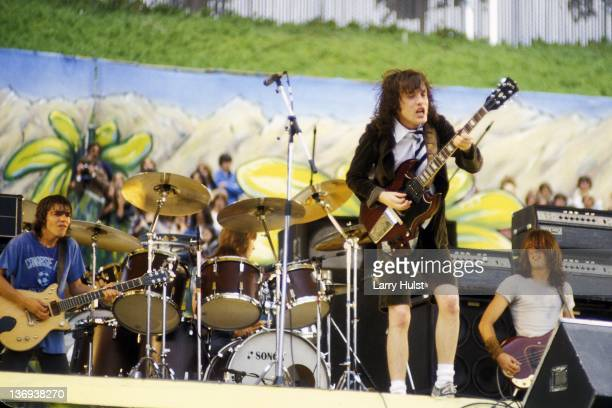 Malcolm Young Angus Young and Cliff Williams performing with 'AC/DC' at the Oakland Coliseum in Oakland California on AUGUST 21 1979