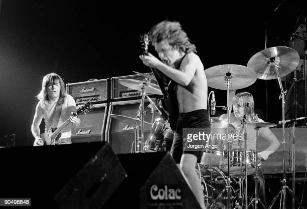 Malcolm Young Angus Young Phil Rudd from AC/DC perform live on stage in Copenhagen Denmark in April 1977
