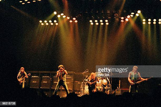 Malcolm Young Brian Johnson Angus Young and Cliff Williams of AC/DC perform on stage at Wembley Arena on January 17th 1986 in London United Kingdom