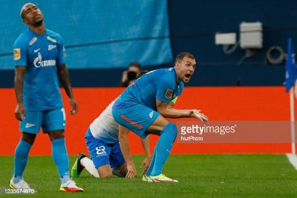 Malcom and Artem Dzyuba of Zenit react during the Russian Premier League match between FC Zenit Saint Petersburg and FC Sochi on October 3, 2021 at...