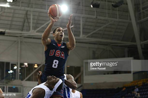 TORONTO ON JULY 22 Malcom Broddon goes up over Elias Ayuso as Team USA beats Team Puerto Rico in the Pan Am basketball tournament at Ryerson Athletic...