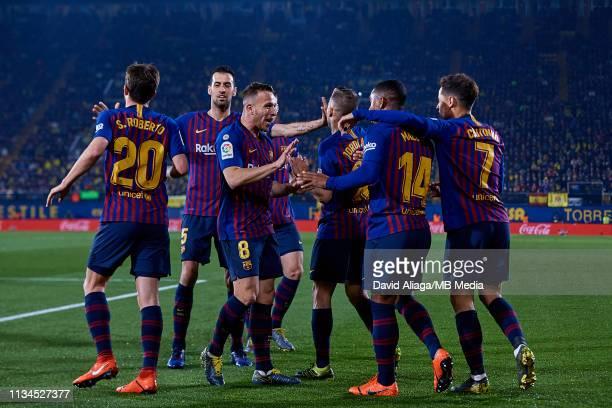 Malcom Filipe Silva de Oliveira of FC Barcelona celebrates his sides second goal with his teammates during the La Liga match between Villarreal CF...