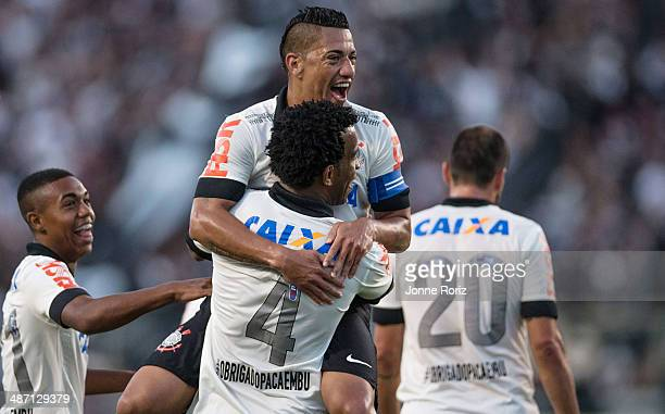 Malcom Gil Ralf and Danilo of Corinthians celebrates the second goal during the Brasileirao Series A 2014 match between Corinthians and Flamengo at...
