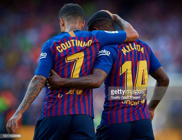 Malcom of Barcelona celebrates with Philippe Coutinho of Barcelona after scoring a goal during the Joan Gamper Trophy match between FC Barcelona and...